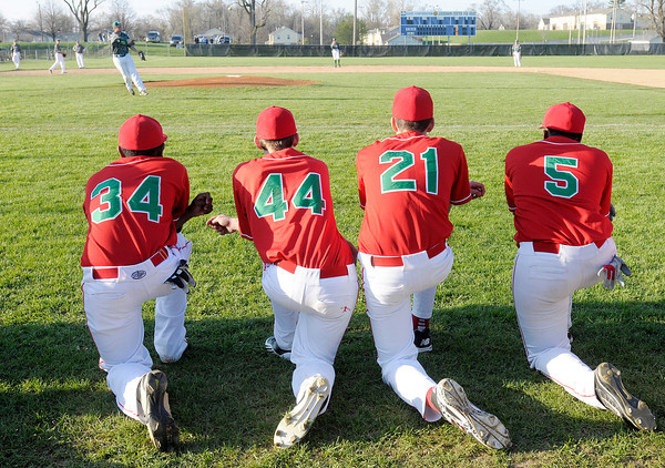 Don Knight | The Herald Bulletin<br /> Anderson players watch Pendleton Heights take their infield practice prior to the start of the Nick Muller Memorial Baseball Tournament championship on Saturday at Memorial Field.