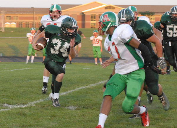 Will Galliher carries the ball downfield for the Pendleton Heights Arabians during their home game Friday against the Anderson Indians.