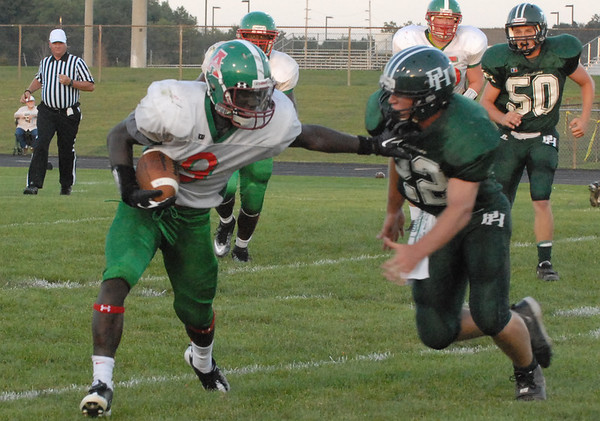 Anderson Indian running back Jerian Beard fights off an Arabian defender during the first quarter of Friday night's contest at Pendleton Heights.