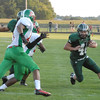 Pendleton Heights running back Jim Arney brings the ball into Arabian territory.
