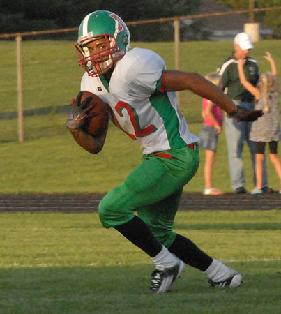 Anderson running back Devante Ramirez carries the ball for the Indians.