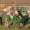 Anderson quarterback Curtis Wilson throws a pass downfield to an Indian receiver.