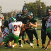Jon Furrow carries the ball for the Arabians early in the first quarter.