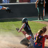 Pendleton Heights' Sarah Dixon is called safe at home after colliding with the Elwood catcher in the sixth inning. Pendleton Heights High School defeated Elwood High School 5 to 1 to win the county softball tournament Saturday, April 19 at Pendleton. For THB / Richard Sitler