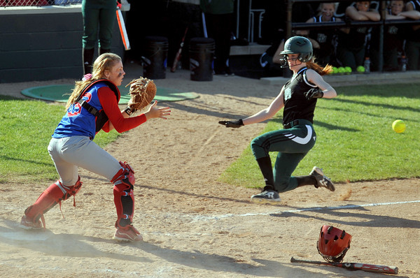 Pendleton Heights' Sarah Dixon slides into home. Pendleton Heights High School defeated Elwood High School 5 to 1 to win the county softball tournament Saturday, April 19 at Pendleton. For THB / Richard Sitler