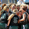Pendleton Heights softball team huddles before the game. Pendleton Heights High School defeated Elwood High School 5 to 1 to win the county softball tournament Saturday, April 19 at Pendleton. For THB / Richard Sitler