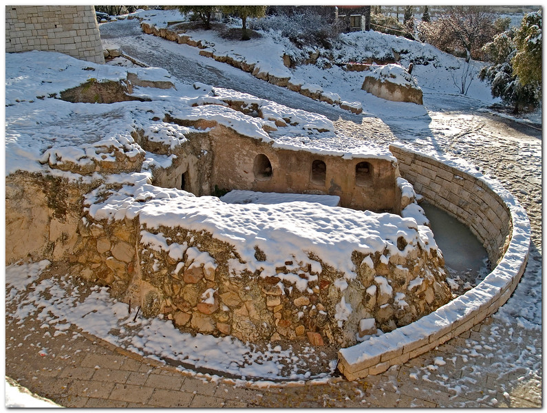 Resting in Snow.<br /> <br /> <br /> Second Temple period Burial cave, (without the cave's roof) on a snowy day. <br /> next to the hebrew university in Mount Scopus, jerusalem.