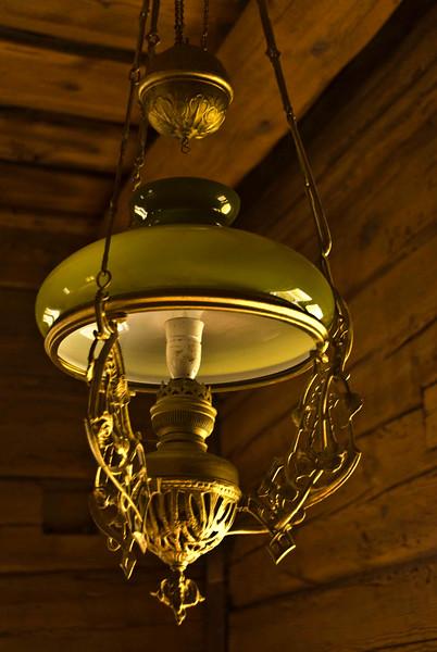 Antique lamp in rural Finland farmhouse.