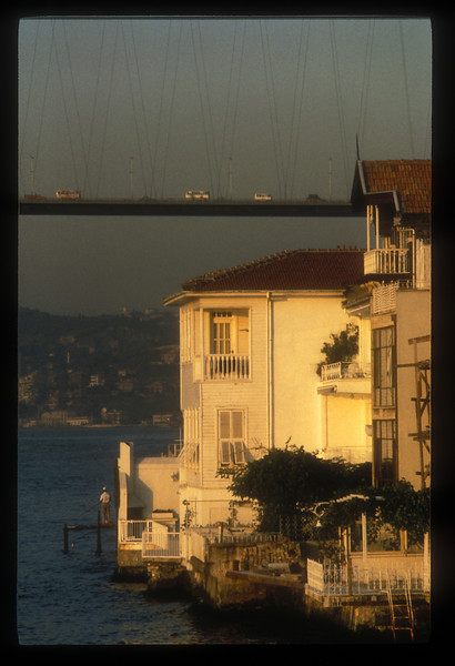 Yalis, old traditional wooden houses along the Bosphorus Strait, and the Bosphorus bridge, Istanbul, Turkey.