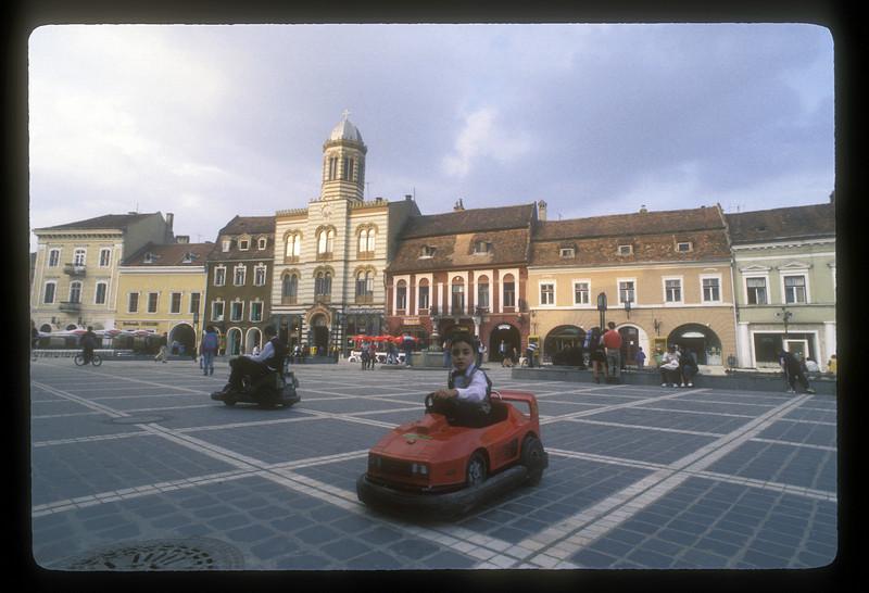 Kids play on the central square in Brasov, Transylvania, Romania.