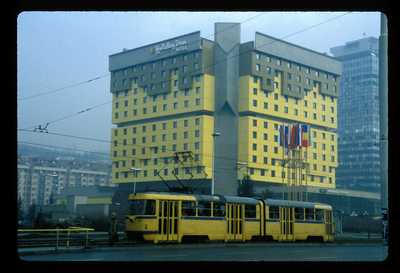Tram and Holiday Inn Hotel, Sarajevo, Bosnia. Hotel payment due in full in advance in cash, in Deutsch Marks, 1997.