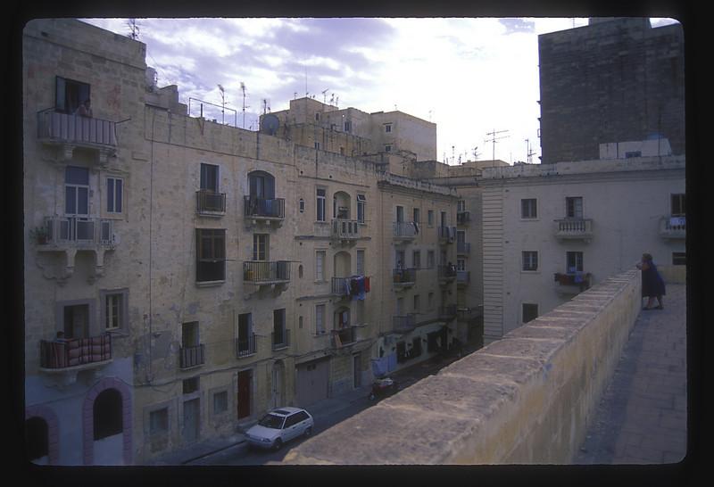 A little gossip across the street, downtown Valetta, Malta.