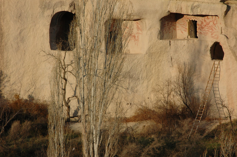 Detail of cave dwellings with entrance ladder, Cappadocia.