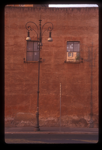 Lamp post and wall, Rome, Italy.