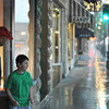 Lance Lawson and son Aiden, 7, get ready to make a dash across Main Street to get into their car during Tuesday's thunderstorm. The downpour brought 1.1 inches of rain in 15 minutes. Several flashfloods were reported in the Sheridan area.