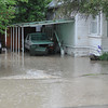 Storm water floods a resident's house on Loucks Street after a torrent of rain from a thunderstorm Tuesday evening.