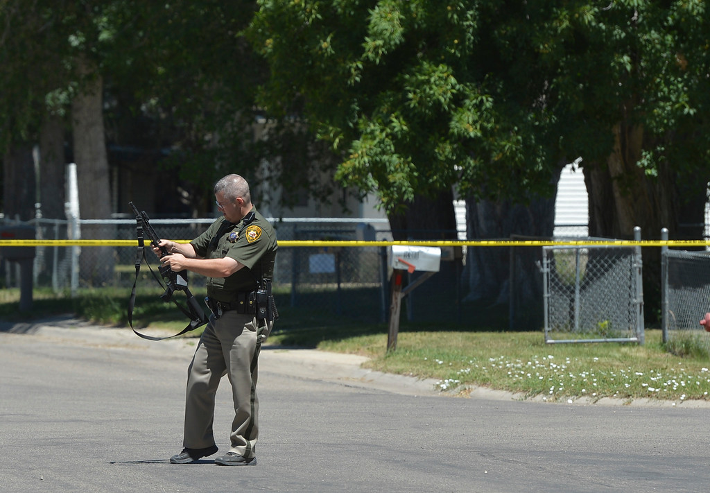 Justin Sheely | The Sheridan Press<br /> A Wyoming Highway Patrol trooper holds a rifle near the scene where a man was reportedly firing guns in random directions Wednesday afternoon on Spaulding Street. A man was arrested Wednesday after firing multiple guns at his home in north Sheridan. The man, identified as Adam Heldik, presents no threat to the public, Sheridan Police Department Lt. Travis Koltiska said. There is no indication he was attempting to shoot at anyone, although he was firing in random directions from his porch, according to a neighbor who witnessed the event. The home is near the corner of West Ninth Street and Spaulding Street, roughly four blocks from the police department.