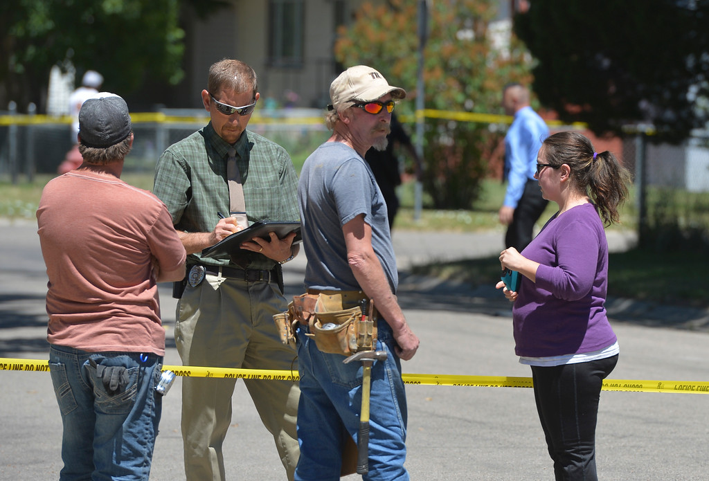 Justin Sheely   The Sheridan Press<br /> Sheridan Police interview witnesses after a man reportedly fired guns in random directions Wednesday afternoon on Spaulding Street. A man was arrested Wednesday after firing multiple guns at his home in north Sheridan. The man, identified as Adam Heldik, presents no threat to the public, Sheridan Police Department Lt. Travis Koltiska said. There is no indication he was attempting to shoot at anyone, although he was firing in random directions from his porch, according to a neighbor who witnessed the event. The home is near the corner of West Ninth Street and Spaulding Street, roughly four blocks from the police department.