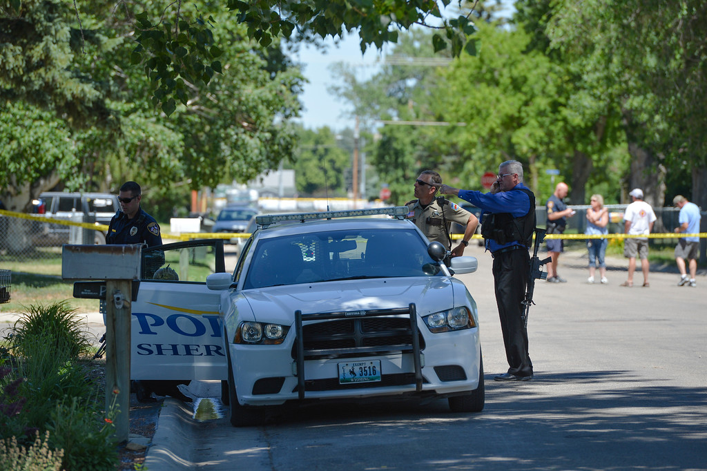 Justin Sheely   The Sheridan Press<br /> Authorities stand by a patrol car after arresting a man who was reportedly firing guns in random directions Wednesday afternoon on Spaulding Street. A man was arrested Wednesday after firing multiple guns at his home in north Sheridan. The man, identified as Adam Heldik, presents no threat to the public, Sheridan Police Department Lt. Travis Koltiska said. There is no indication he was attempting to shoot at anyone, although he was firing in random directions from his porch, according to a neighbor who witnessed the event. The home is near the corner of West Ninth Street and Spaulding Street, roughly four blocks from the police department.