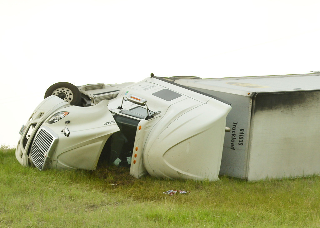 A semi-truck is seen on its side after strong winds blew it over on the I-90 off ramp from the exit 16 at the port of entry Tuesday afternoon. The Sheridan Press|Justin Sheely