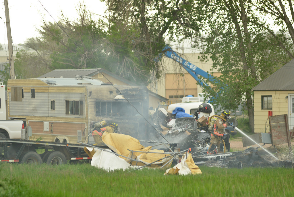 Sheridan Fire-Rescue put out a structure fire on the back of a RV Tuesday afternoon on North Main Street. The Sheridan Press|Justin Sheely