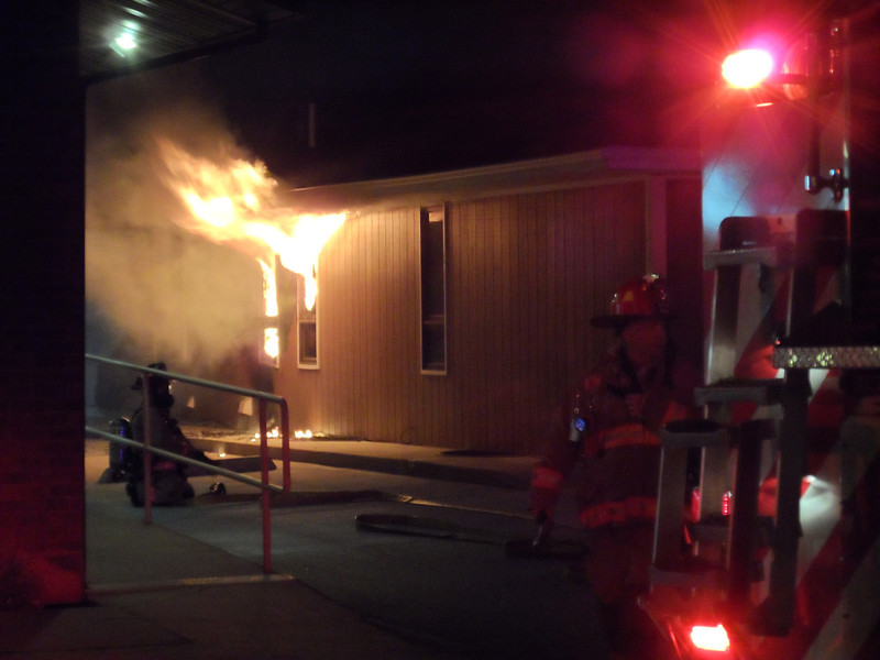 Sheridan Fire-Rescue firemen respond to a structure fire Saturday night at 9:36 p.m. on Coffeen Avenue. (Justin Sheely/The Sheridan Press)