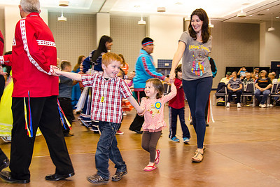 Zakk Shamholtzer, 4, joins Becca Patton and daughter Kaia, 2, for the Snake Dance.