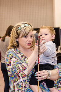 Kari Gossvener od Healdton and her one year old nephew Tate Idleman of Wilson examine a Choctaw arrow.