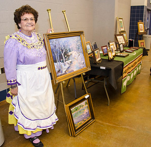 Mary Ann Allen proudly displays her artwork at the Ardmore meeting.