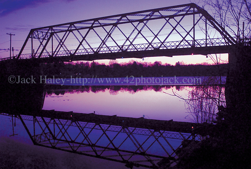 jheriebridge - A one lane bridge over the Erie Canal in Port Gibson cast it's own reflection down on the water as the final light from the sun dips down over the horizon on Saturday evening.