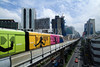 P5.2a-c / As a replacement for the stills suggested on the art grids<br /> <br /> Choice 3 of 10<br /> <br /> iPod ads cover the BTS Skytrain approaching Nana Station on Sukhumvit Road.