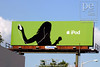 P5.2a-c / As a replacement for the stills suggested on the art grids<br /> <br /> Choice 5 of 10<br /> <br /> Green billboard advertising iPod mp3 player features silhouette of a woman