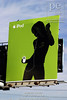 P5.2a-c / As a replacement for the stills suggested on the art grids<br /> <br /> Choice 10 of 10<br /> <br /> Green billboard advertising iPod mp3 player features silhouette of a woman dancing to music playing on her headphones
