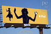 P5.2a-c / As a replacement for the stills suggested on the art grids<br /> <br /> Choice 9 of 10<br /> <br /> Yellow billboard advertising iPod mp3 player features silhouette of a woman dancing to music playing on her headphones