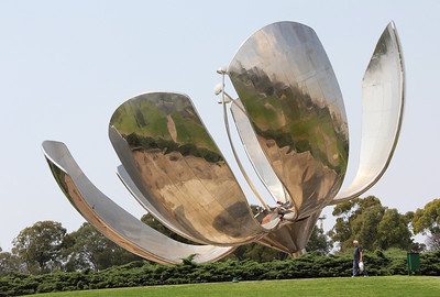 this big metal flower follows the sun