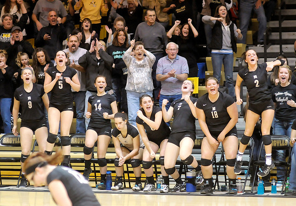 Don Knight/The Herald Bulletin<br /> Madison-Grant's bench reacts as the Argylls win the third set in a come frome behind victory to defeated Muncie Burris on Tuesday.