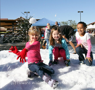 (Maricopa, Az 12/9/2012) While the children of Maricopa are used to 120 degree days in the summer, they had no problem figuring out how to play in the snow. The local Basha's market sponsored a Winterfest on Saturday that featured venders, Santa and snow. This was one of 2 snow events in Maricopa on Saturday and one of 3 in the last week. All of the events were very well received and seemed to help residents to get into Holliday spirit.