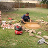 Firepit Construction <br /> Clint lays the foundation to the fire pit in the backyard.