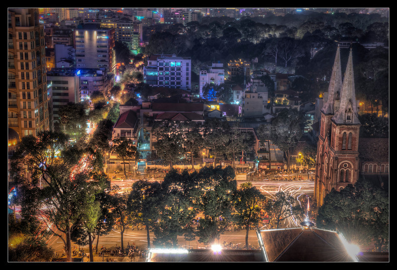 Notre Dame Cathedral and Saigon, Vietnam at Night.