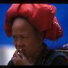 Snacking hill tribe woman, Sa Pa, Vietnam.