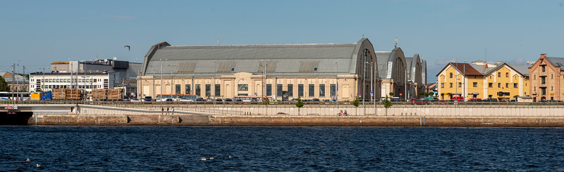 These buildings in Riga, Latvia, were built by Nazi Germany as zeppelin hangars. Since the zeppelin thing never took off, today they are used as a sprawling central market.