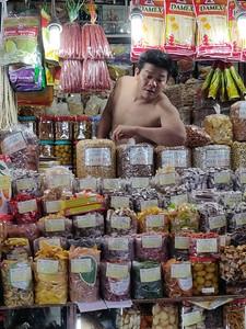 It gets hot in the Ben Thanh market, Saigon, Vietnam.