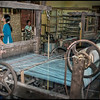 """Loom at sewing factory, Hoi An, Vietnam.<br /> <br /> Here's a four-minute video from Hoi An: <br /> <a href=""""https://www.youtube.com/watch?v=fNOfkNc9AJE"""">https://www.youtube.com/watch?v=fNOfkNc9AJE</a>"""