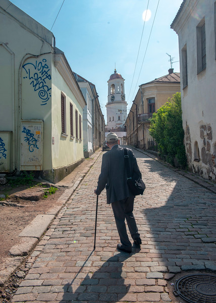 Old man in old town, Vyborg, Russia, June, 2019.