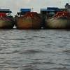 Three boats in the Mekong delta, Vietnam.