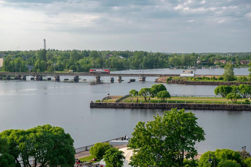 Lumber train rolls into town, Vyborg, Russia.