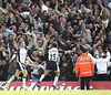 Keane and Lennon celebrate Tottenham's goal in the 66th minute as the visiting fans go crazy behind them.  Goal should never have happened...