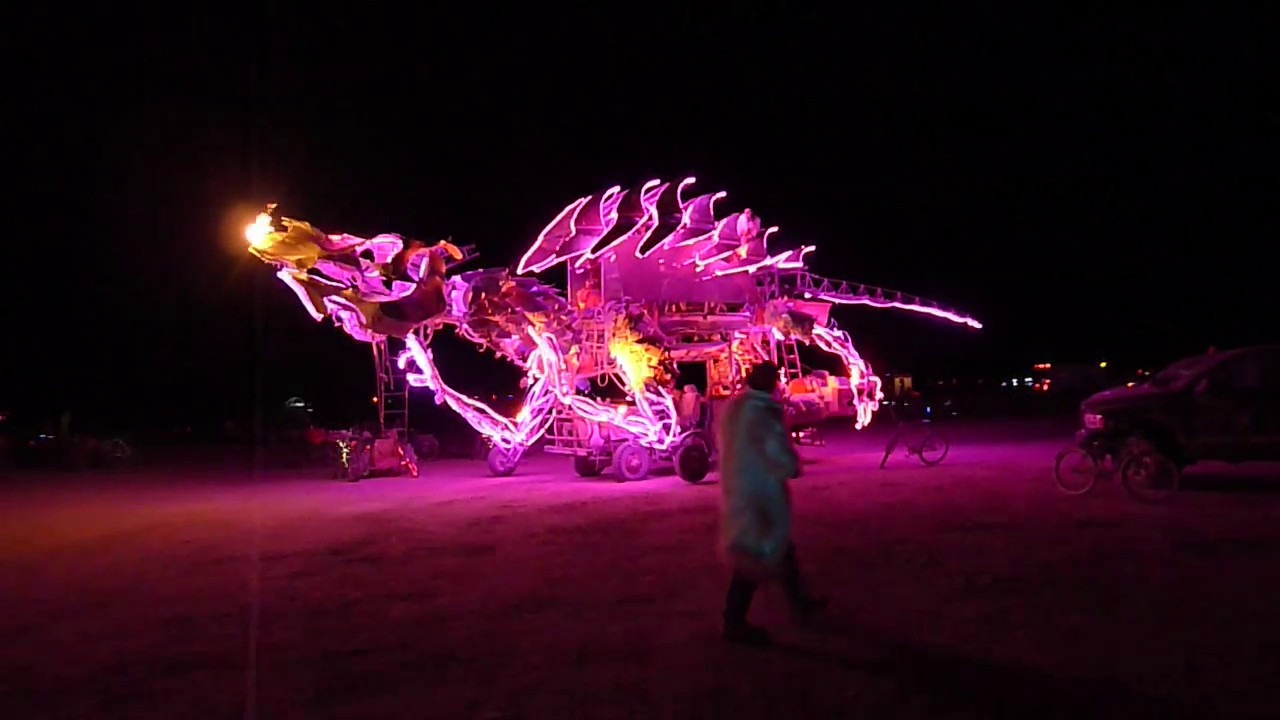 I don't know the name of this art car. The guy talking to me was worried that the art car would not show up on my video because it's night.
