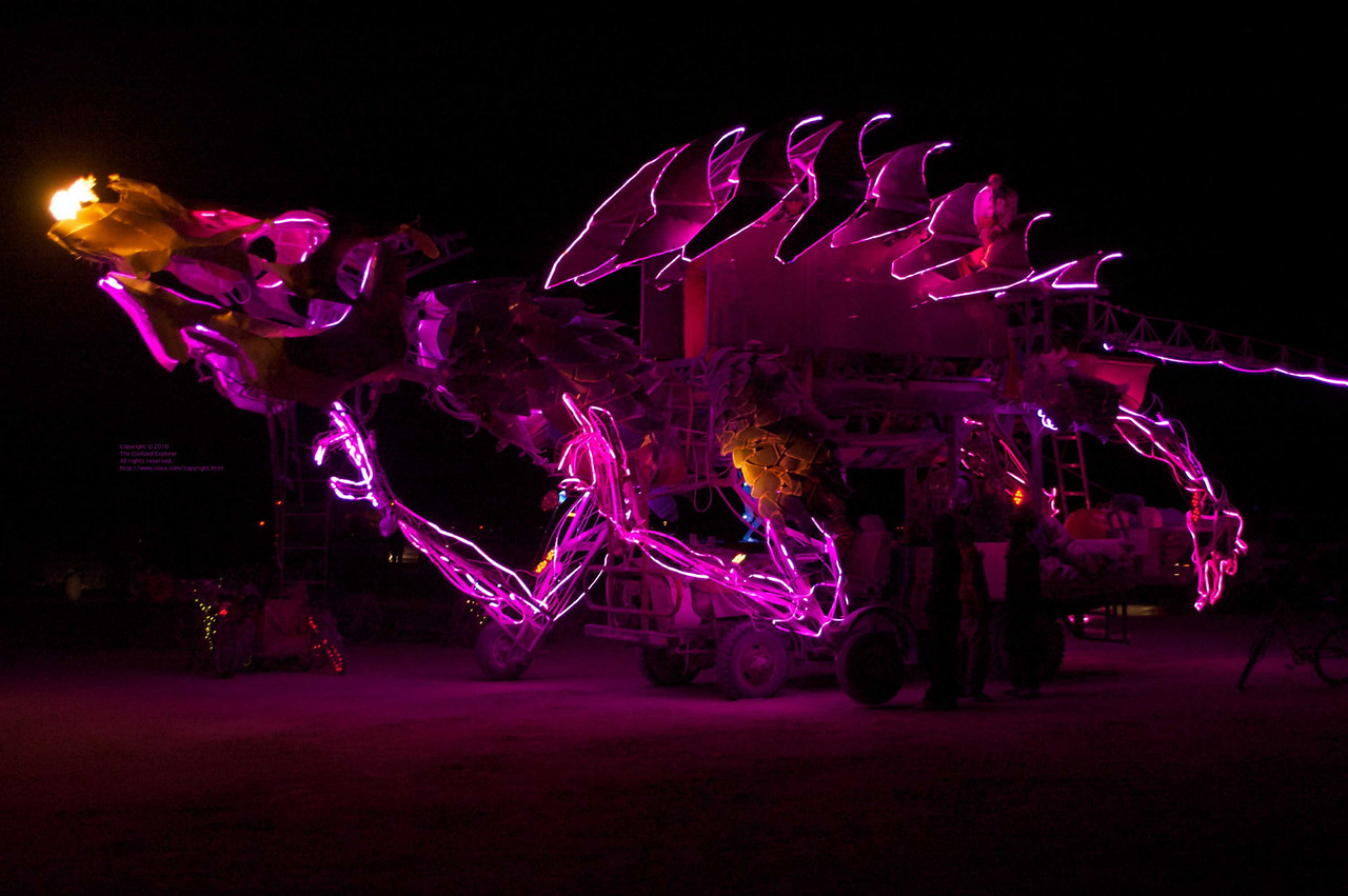 A dragon art car with flames.