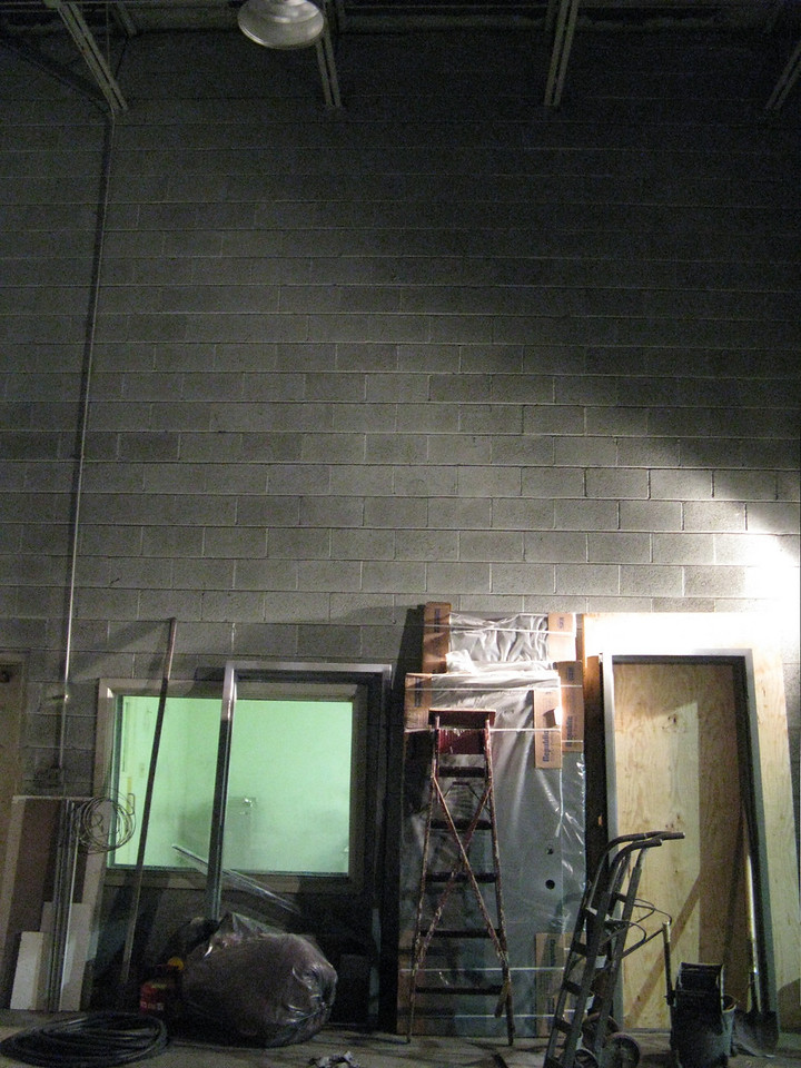 Entrance/greeter area, right wall (as you enter), doorway & window to break room/kitchen